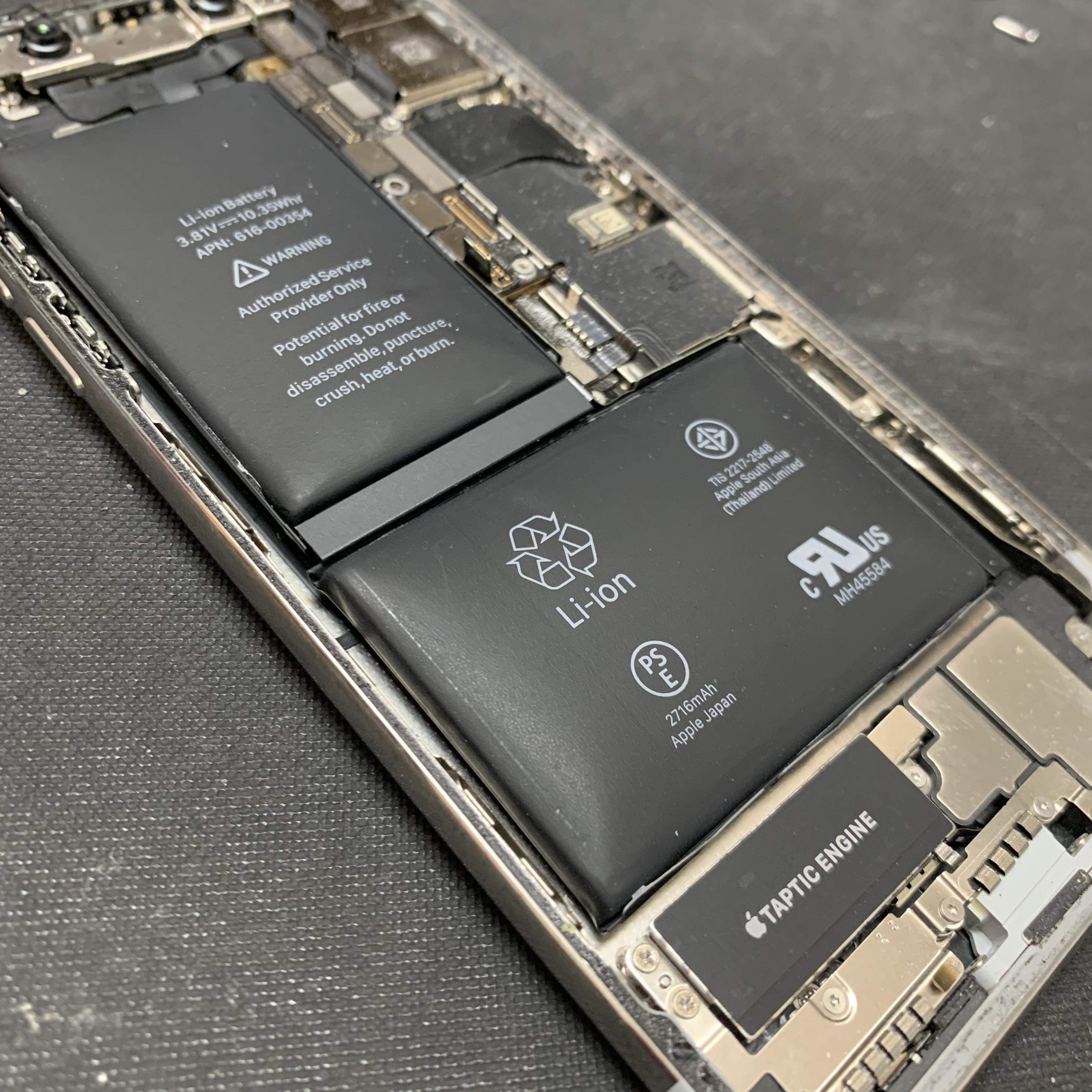 膨張したiPhoneXのバッテリー